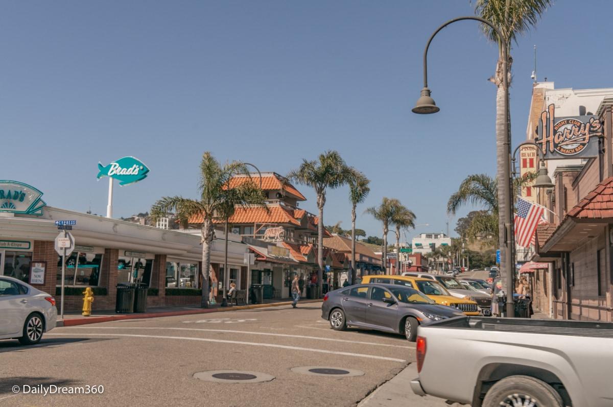 Street view of beach shops in Pismo Beach CA