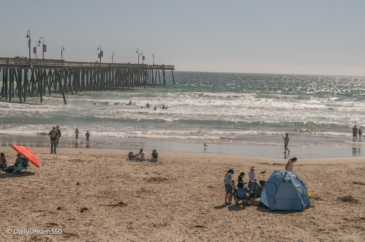People on Pismo Beach with Pier in the background