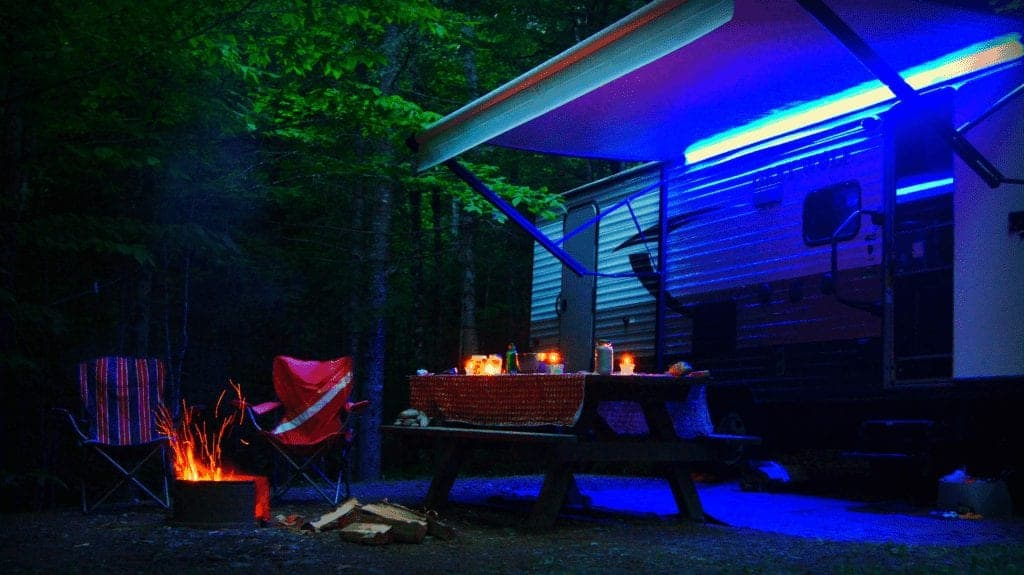 Our campsite in Maine while boondocking at Aroostook State Park. Lit up by our campfire and candles.