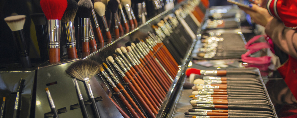 Makeup brushes display on a rack