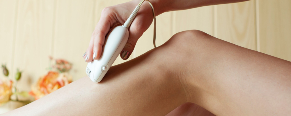 Woman using hair removal device