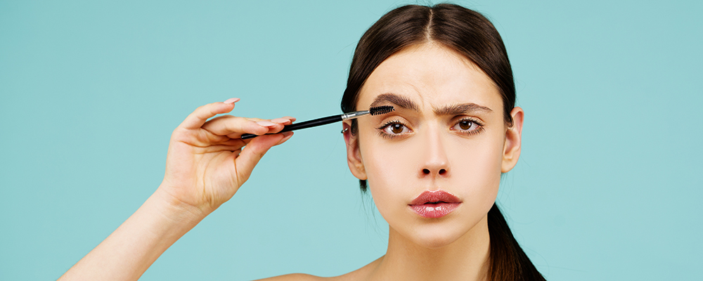 Woman with brow pencil