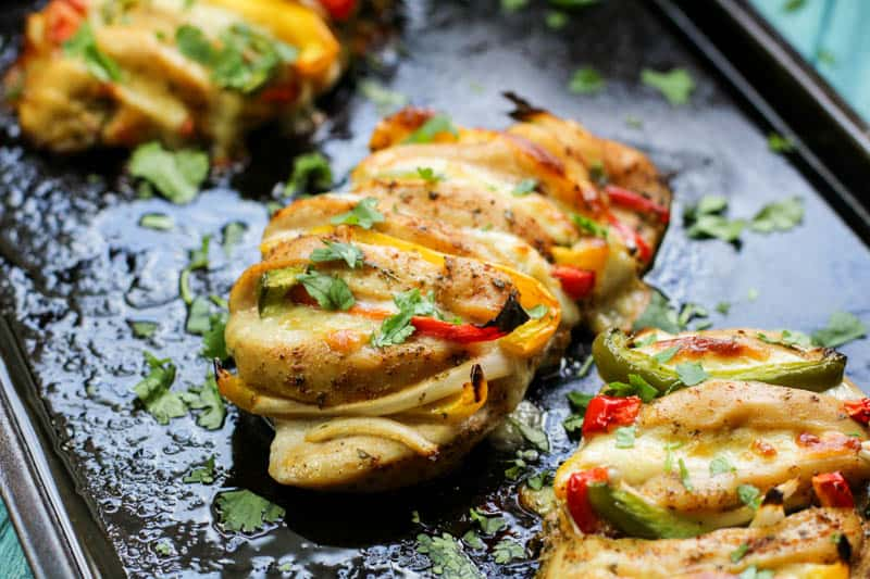 Keto Stuffed Chicken recipe on a black background