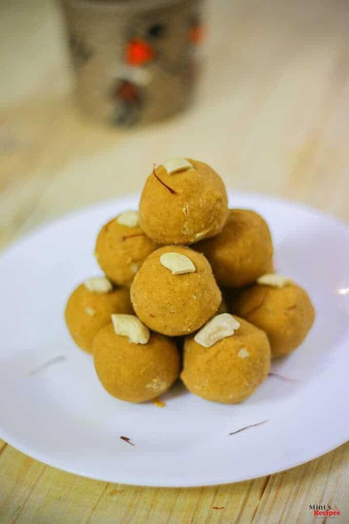 Besan Ke Laddu on a white plate with some cashew