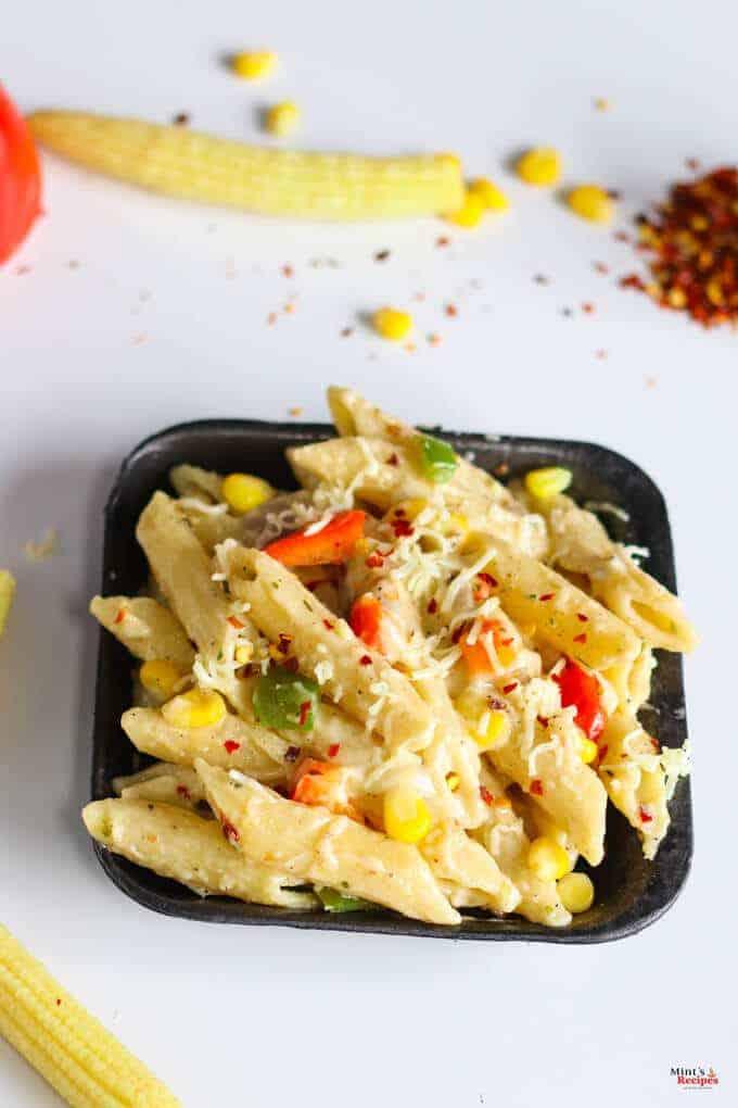 Italian white Sauce Pasta on a black plate