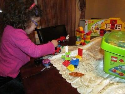 Girl playing with LegoDuplo