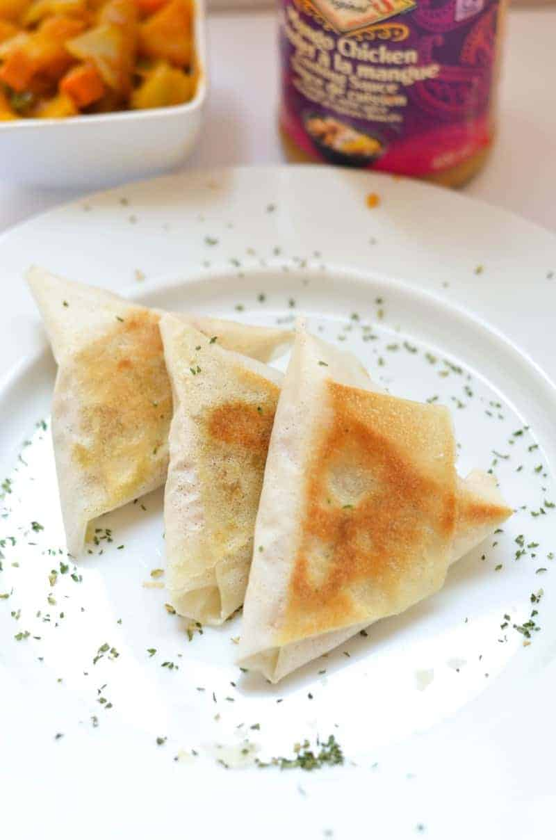 Looking for a not-so-fried spin on your favorite potato samosa recipe? Try this delicious baked samosa recipe instead! Trust me, you won't miss the fat!