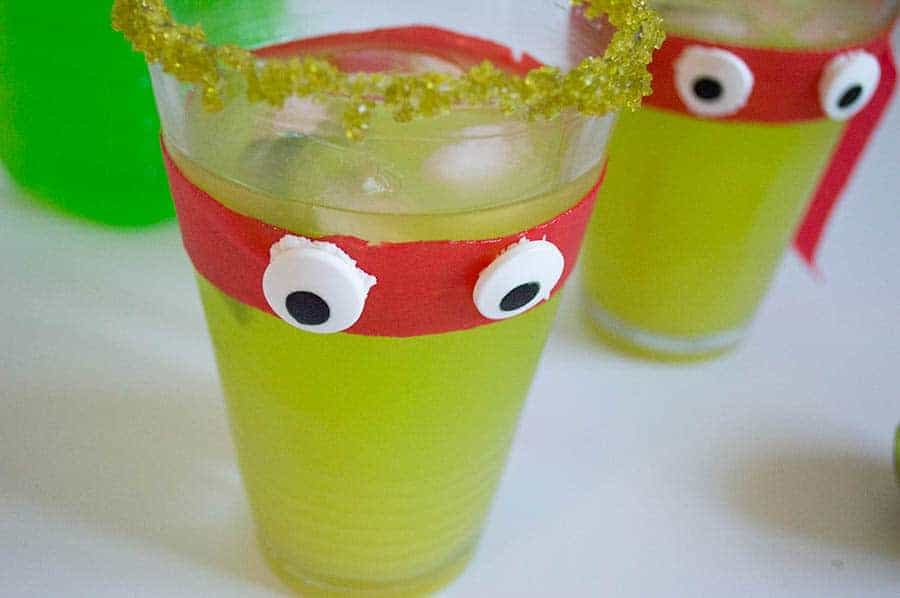 Teenage Mutant Ninja Turtles: Out of Shadows is hitting the theater on June 3rd and my teen wants to celebrate with a pre-movie party! You can't have a party without snacks and drinks, right? What better way to celebrate than with a movie-inspired mocktail for kids? Even little ones can make this cute and funny Teenage Mutant Ninja Turtle punch recipe! It's a delicious party favor. Let's see how you can make it.