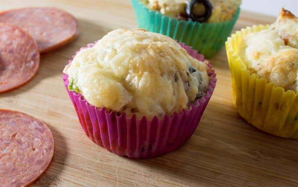 Want to make the most delicious pizza muffin ever? Check out our recipe and #1 tip for making this easy recipe over-the-top amazing!