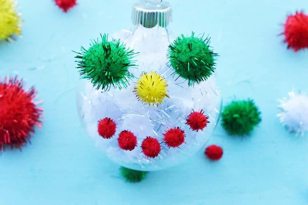 Get a head start on your homemade tree decorations with an easy Christmas craft that's perfect for kids and adults alike with our DIY pom-pom ornaments!