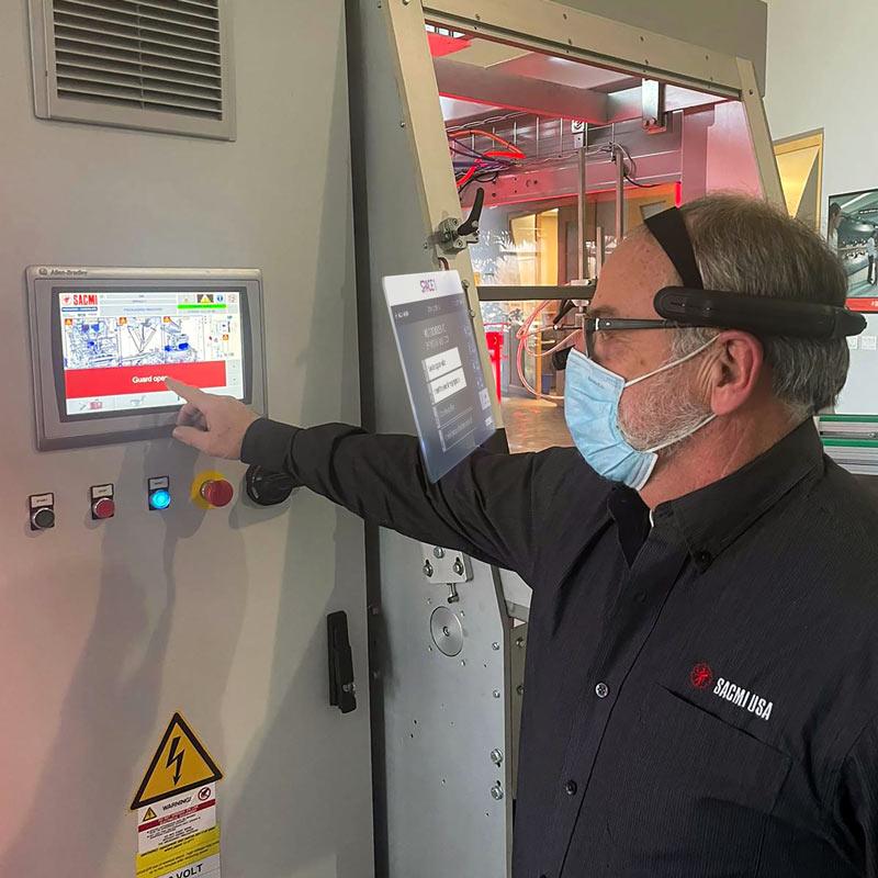 SACMI USA technicians using HMD during maintenance activity