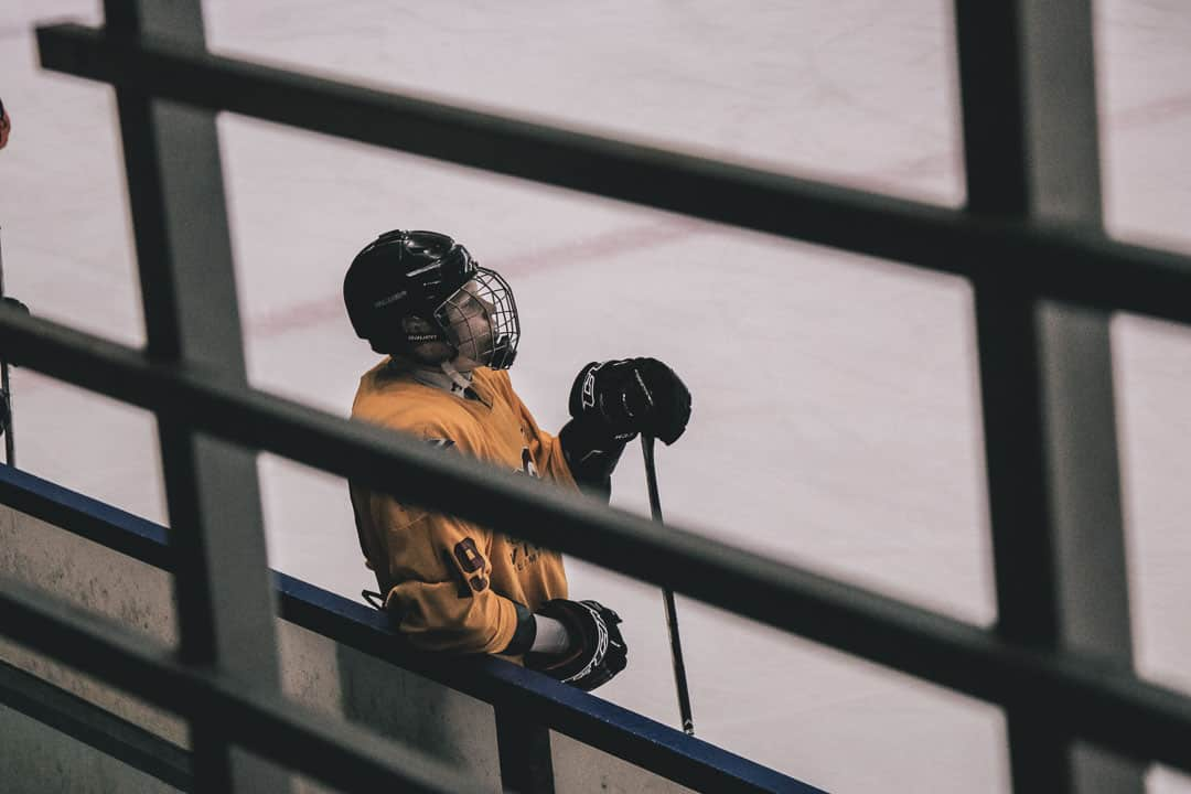 player waiting to run a drill during hockey tryout