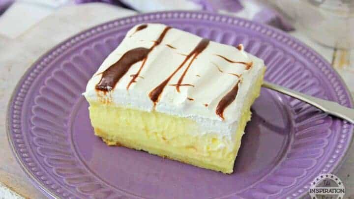 chocolate eclair cake on a purple plate with a dessert fork