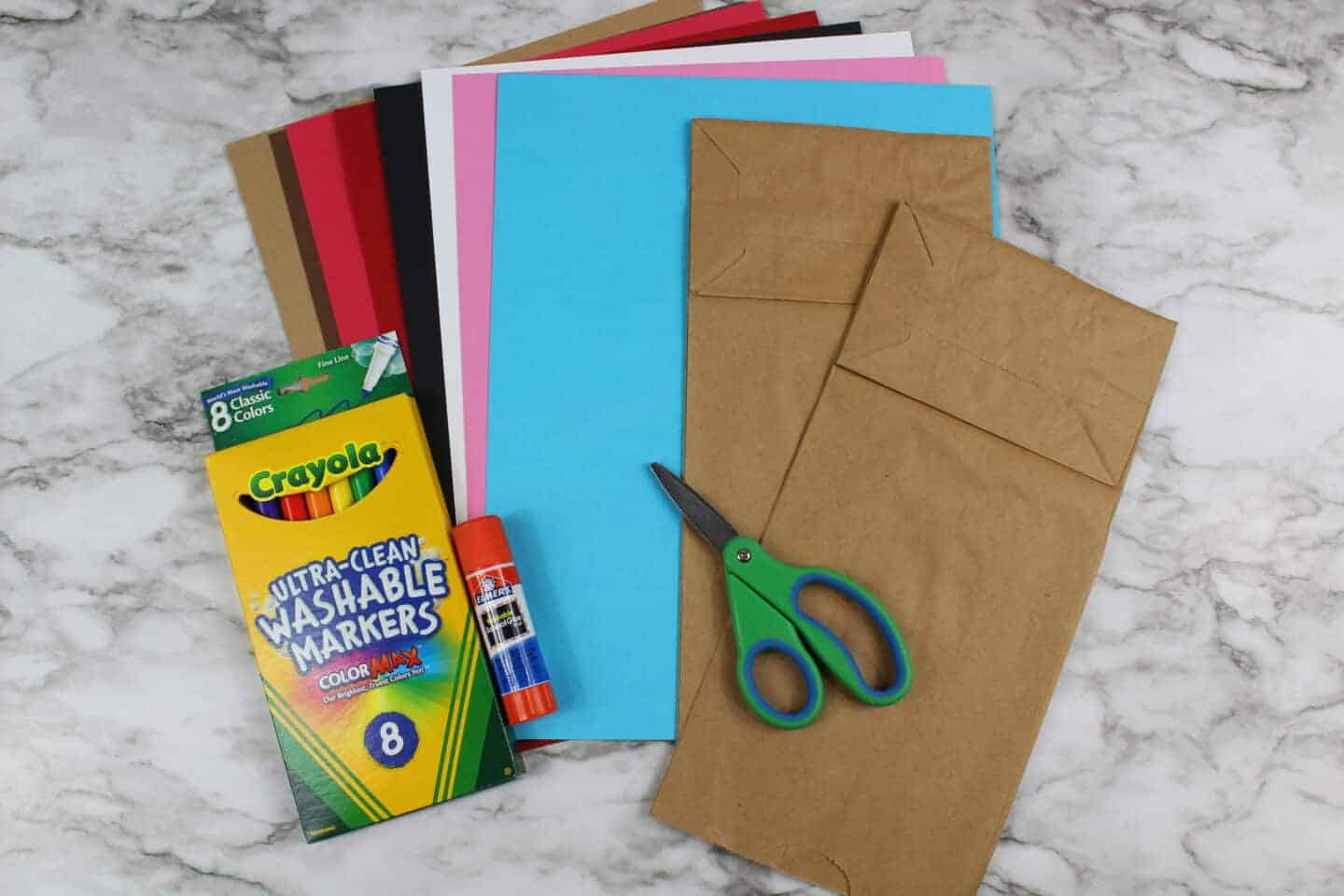 supplies needed for werewolf craft including paper bag, cardstock and crayola felts