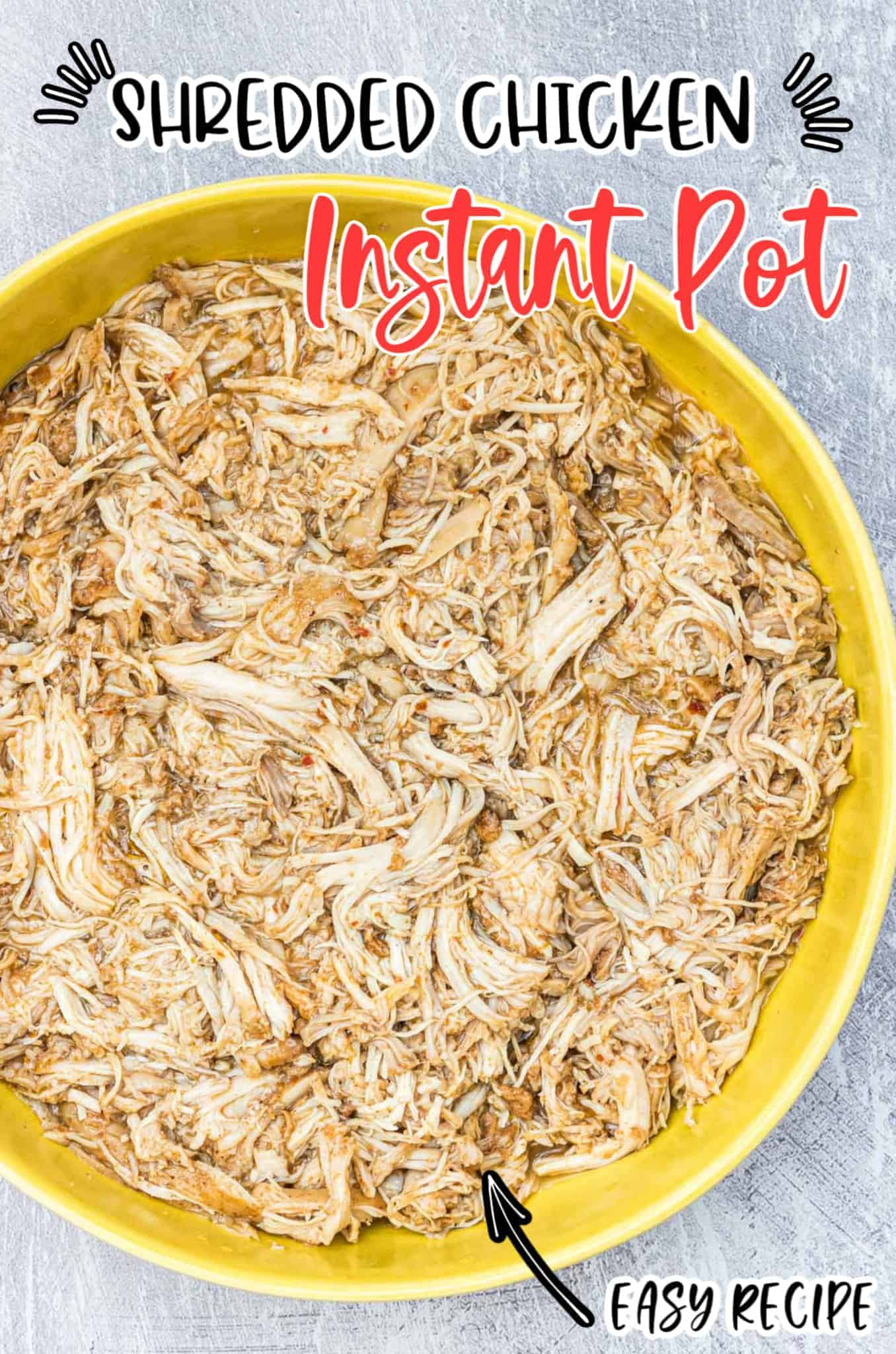instant pot shredded chicken in a yellow bowl