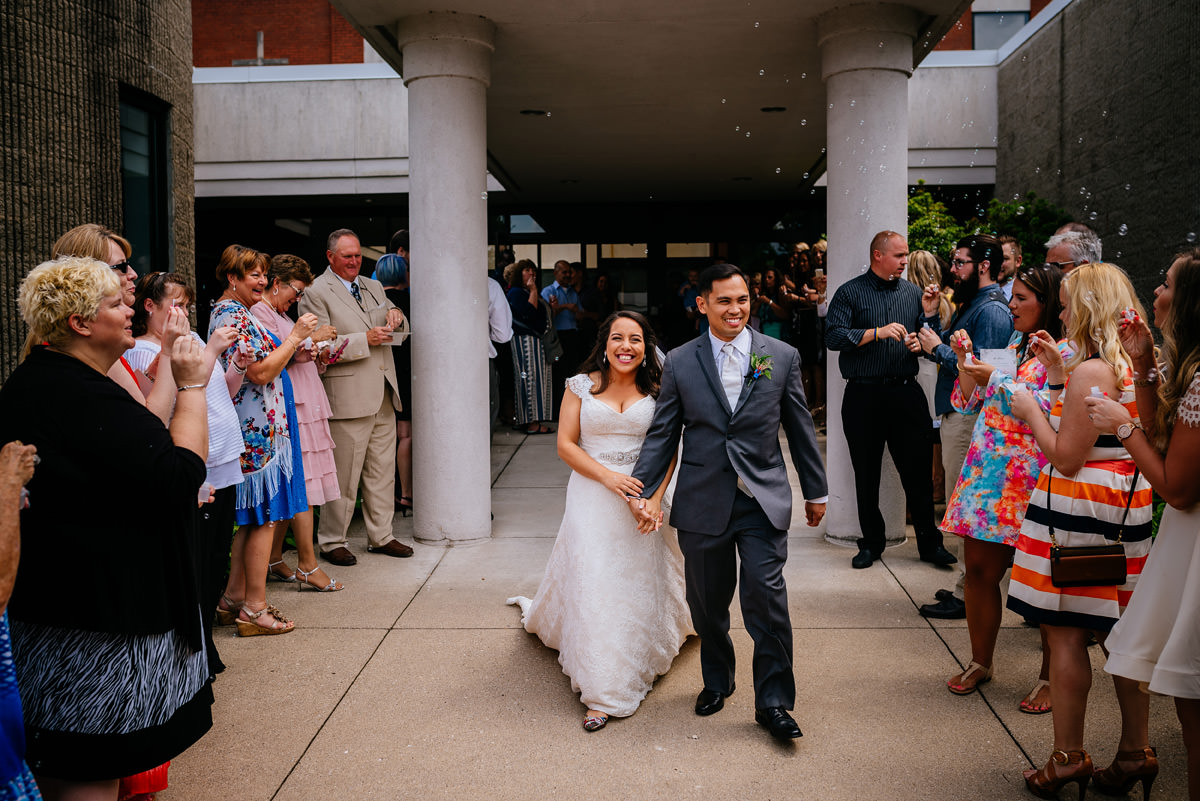 couple exits church with bubbles