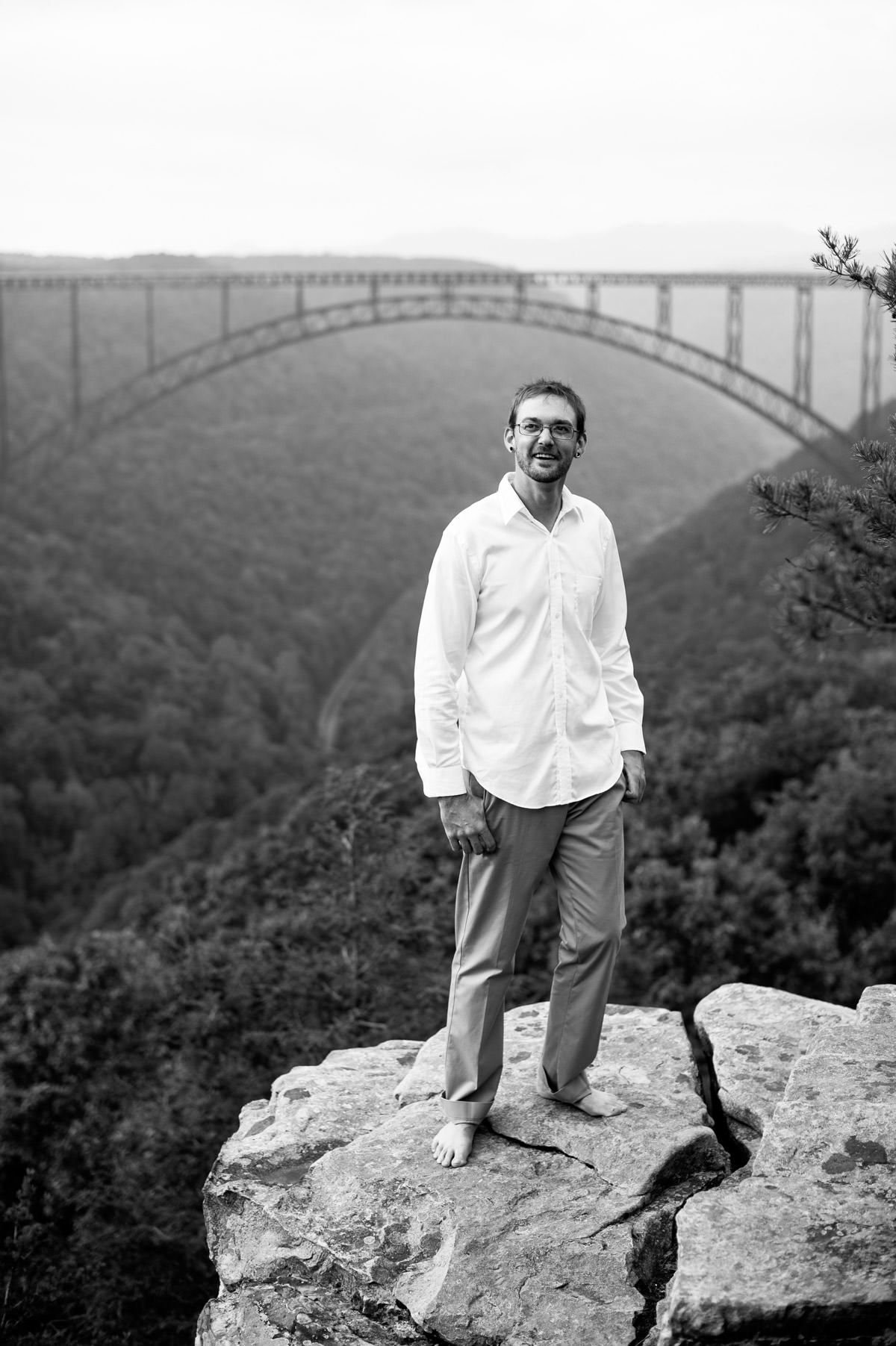 black and white groom portrait at new river gorge overlook
