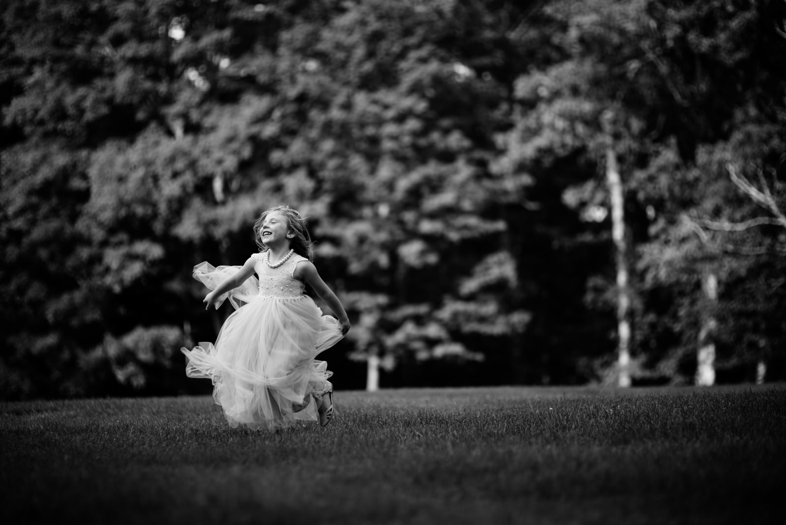 happy flower girl playing during wedding reception