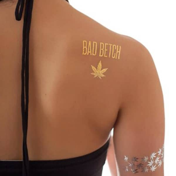 Metallic tattoo displayed on back shoulder and hand