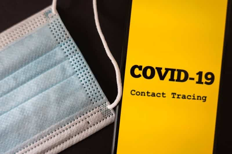 Mask next to COVID-19 Contact Tracing pamphlet