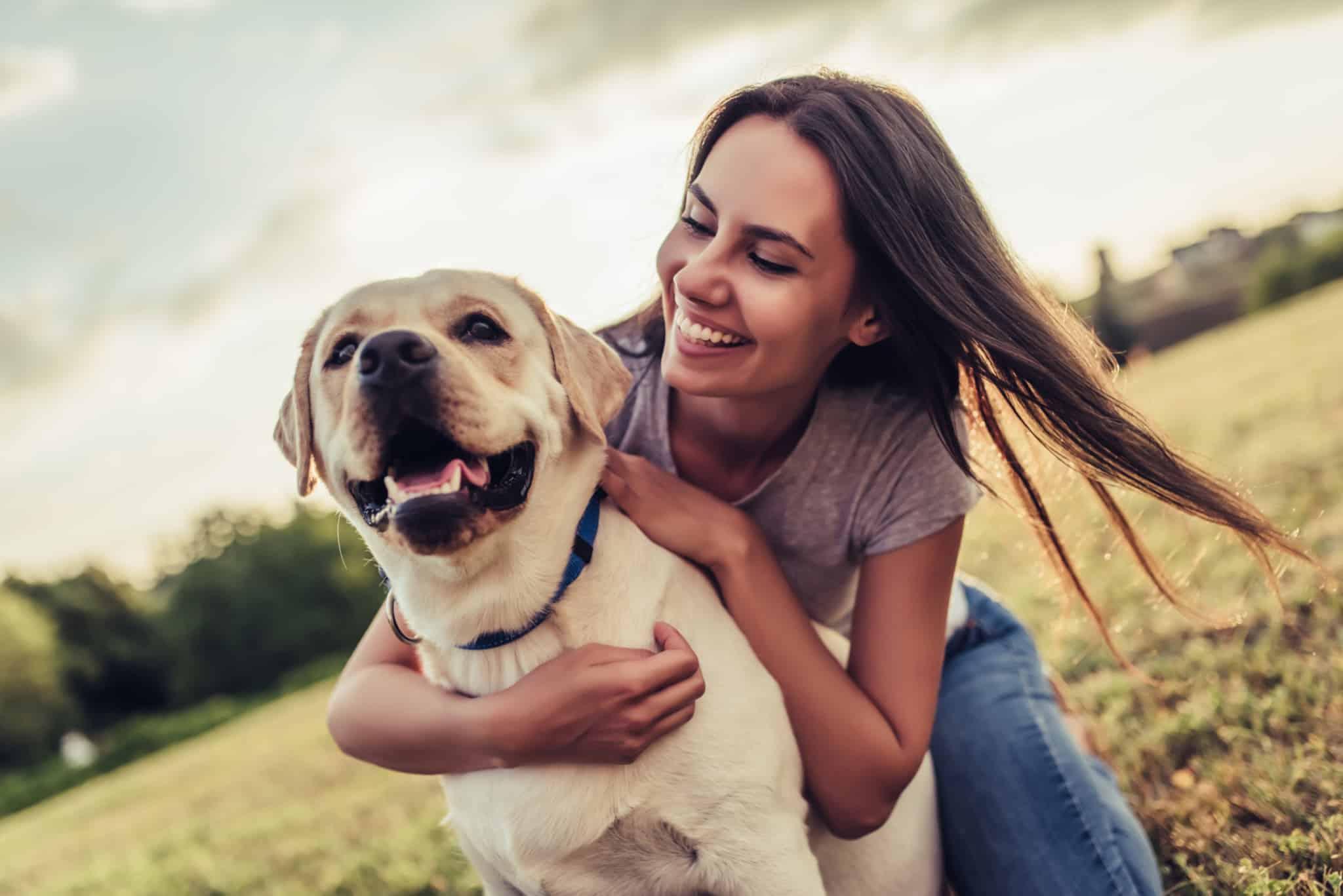 girl loving her dog