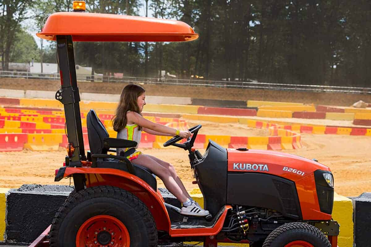 Girl drives Kubota tractor around special course