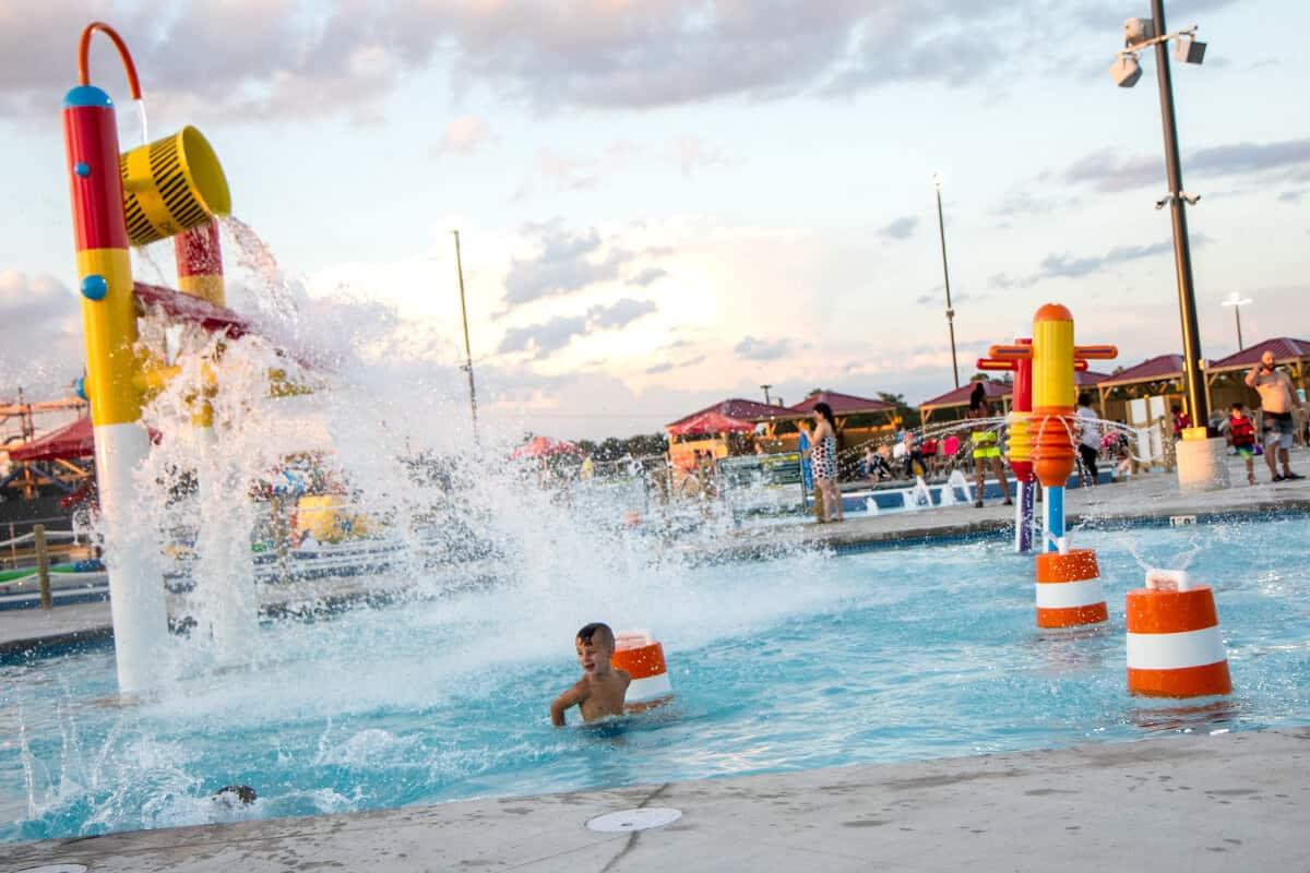 Boy gets splashed by a huge water bucket in Jackhammer Bay