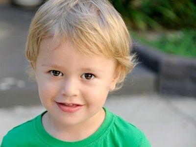 A cute boy smiling