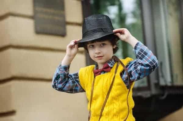 A cowboy wearing a checked shirt