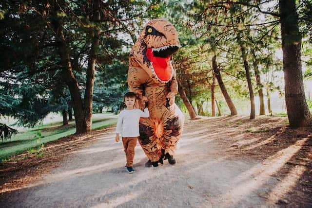 father and son wearing a jurassic park halloween costume