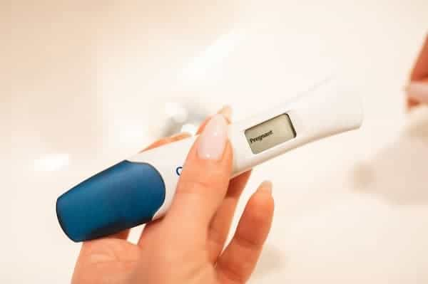 person Holding a positive pregnancy test