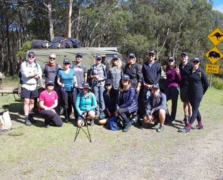 The charity team getting a group photo at the start of the Six Foot Track trek
