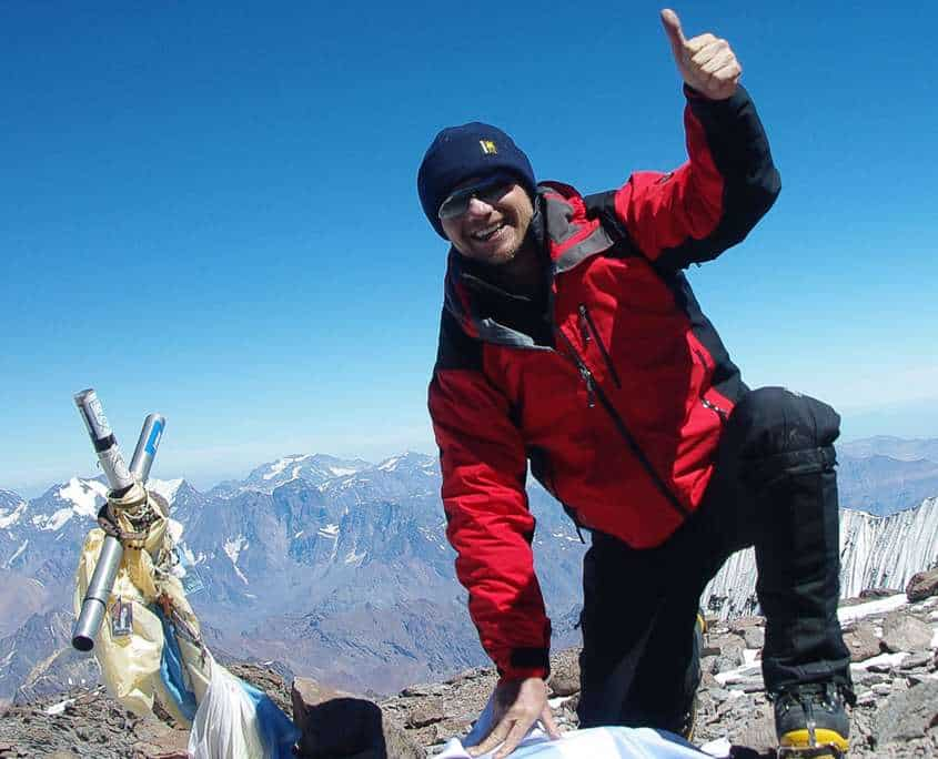 Darren Wise giving a big thumbs up after summiting Mt Aconcagua in Argentina
