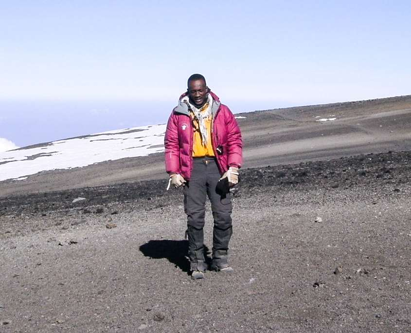 Yess our African local guide on the summit of Mt Kilimanjaro