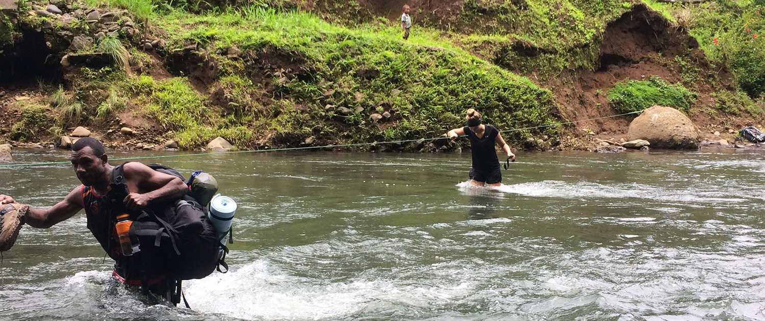 Doing a river crossing on the Kokoda Track in Papaua New Guinea