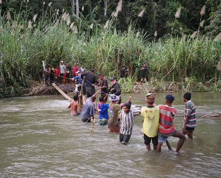 Crossing one of the many rivers on the Kokoda Track