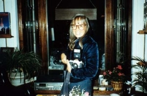 A photo of Mary Eshbaugh Hayes with her camera at Explore Booksellers, 1980.