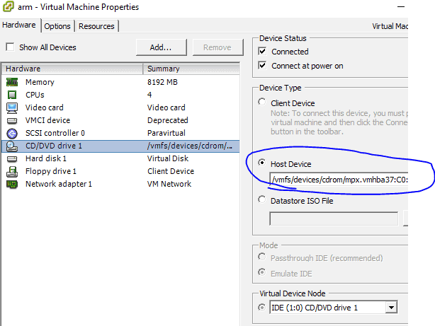 VMware Machine Properties, select CD/DVD drive, set Device Type to Host Device and select the optical drive.
