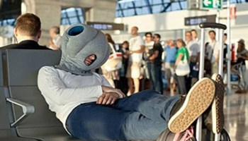 Ostrich Pillow Review | Neck Pillow For Sleeping On The Move