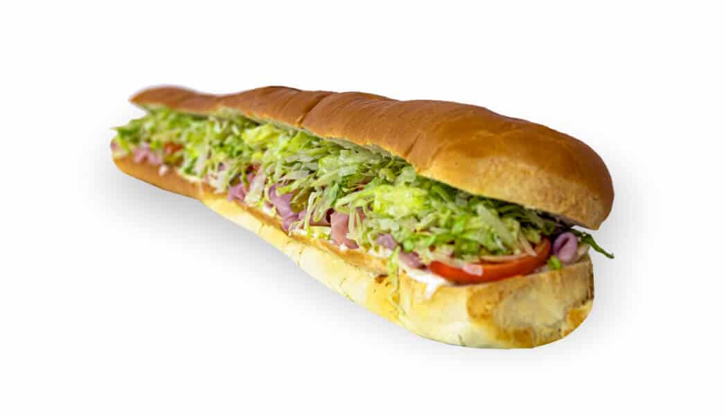 Long sub sandwich with meat, tomatoes, and lettuce