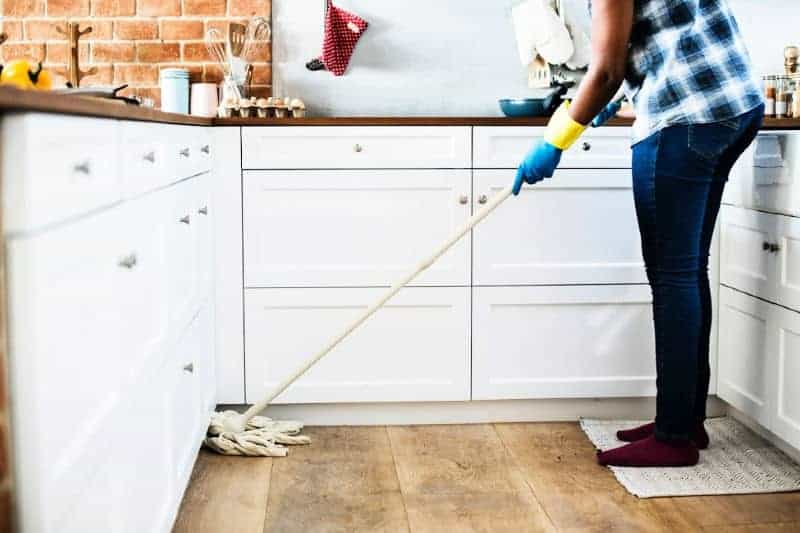Person mopping wood floor