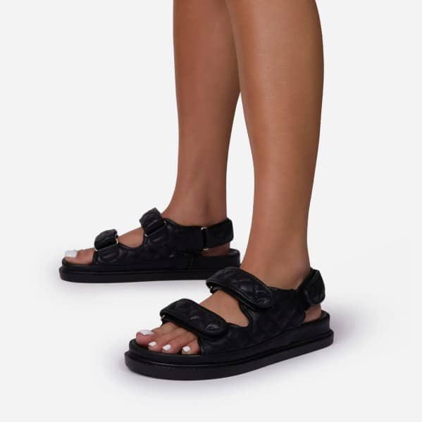 HYPED QUILTED DOUBLE STRAP FLAT DAD SANDAL IN BLACK FAUX LEATHER EGO