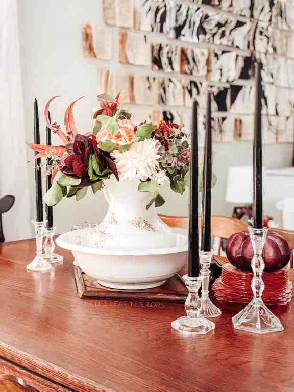 fall centerpiece with ironstone and black taper candles
