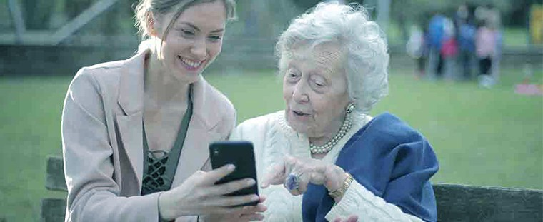 focus on others girl grandmother phone helping help looking other  How to Make a Month Go By Fast