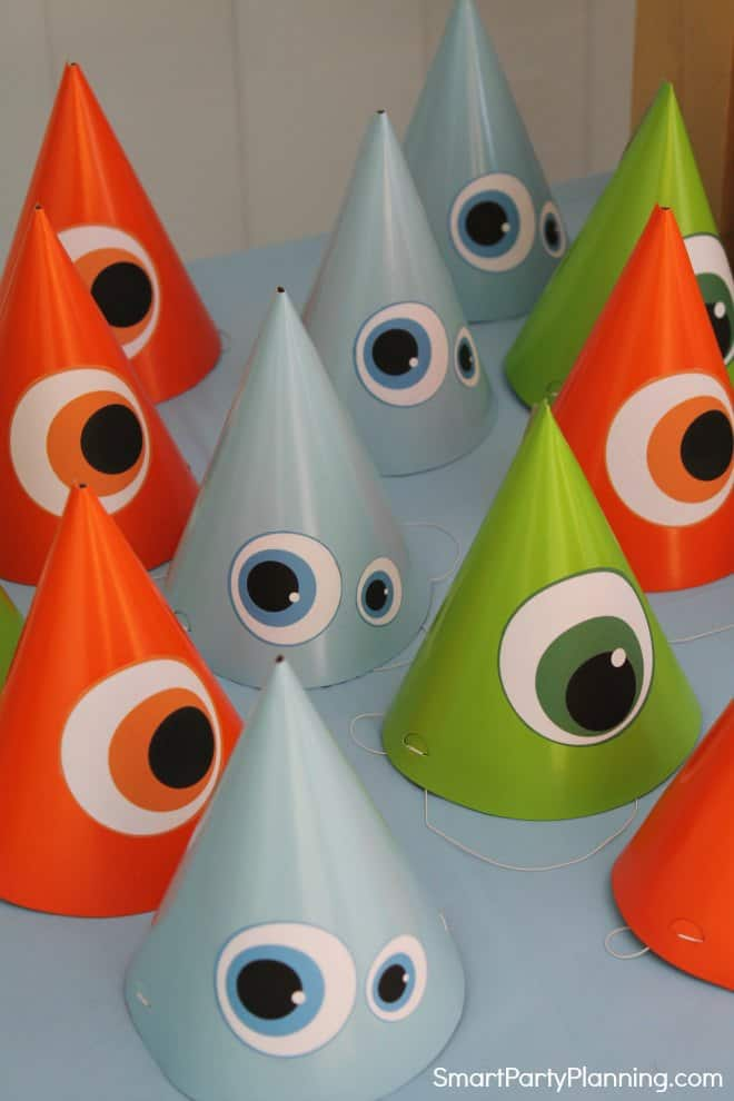 orange, blue and green monster party hats