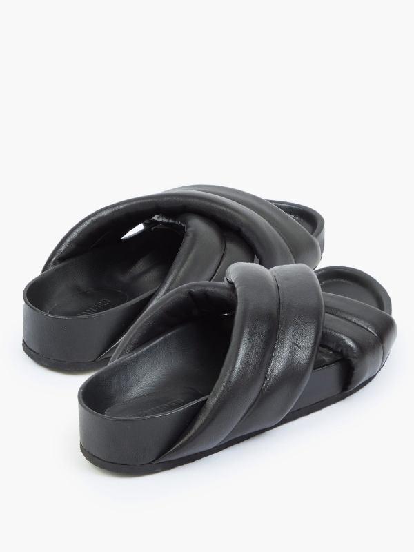 Black Nappa Padded Crossover Leather Slides, £414, Jil Sander at Matches Fashion