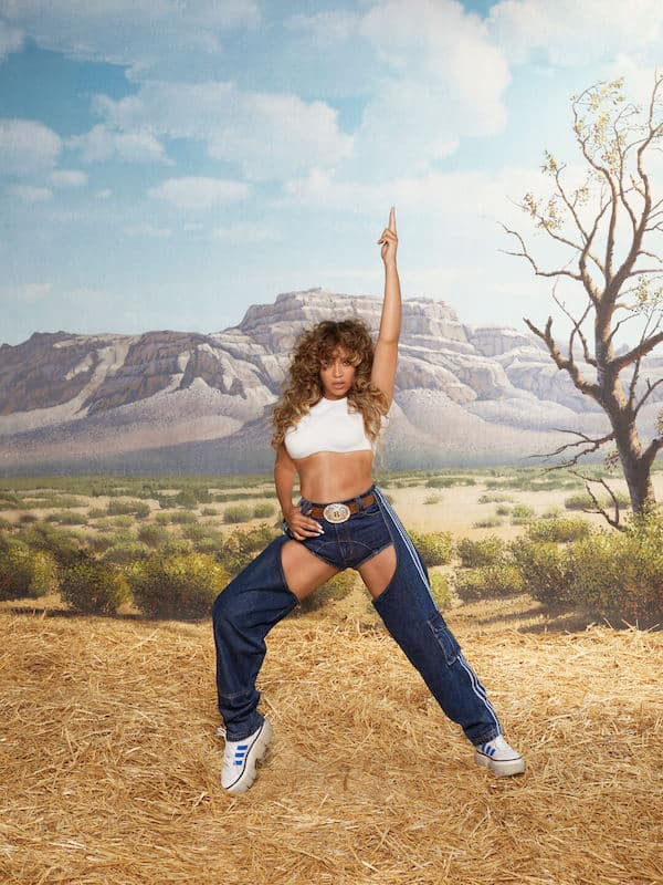 beyonce starring in the adidas x ivy park rodeo campaign wearing denim chaps, super-sleek trainers, western belt and white crop top