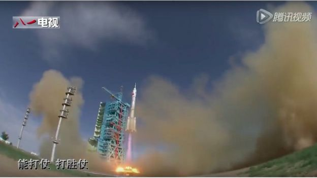 Large space rocket takes off from launch pad and blue-coloured gantry