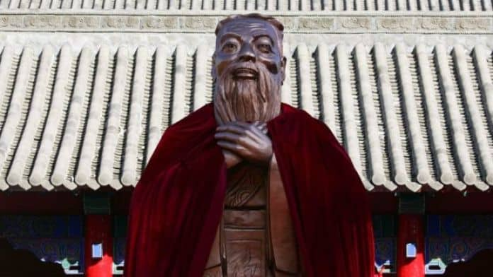 A statue of Confucius stands on display during a ceremony to mark his 2559th birth anniversary at the Changchun Confucian Temple