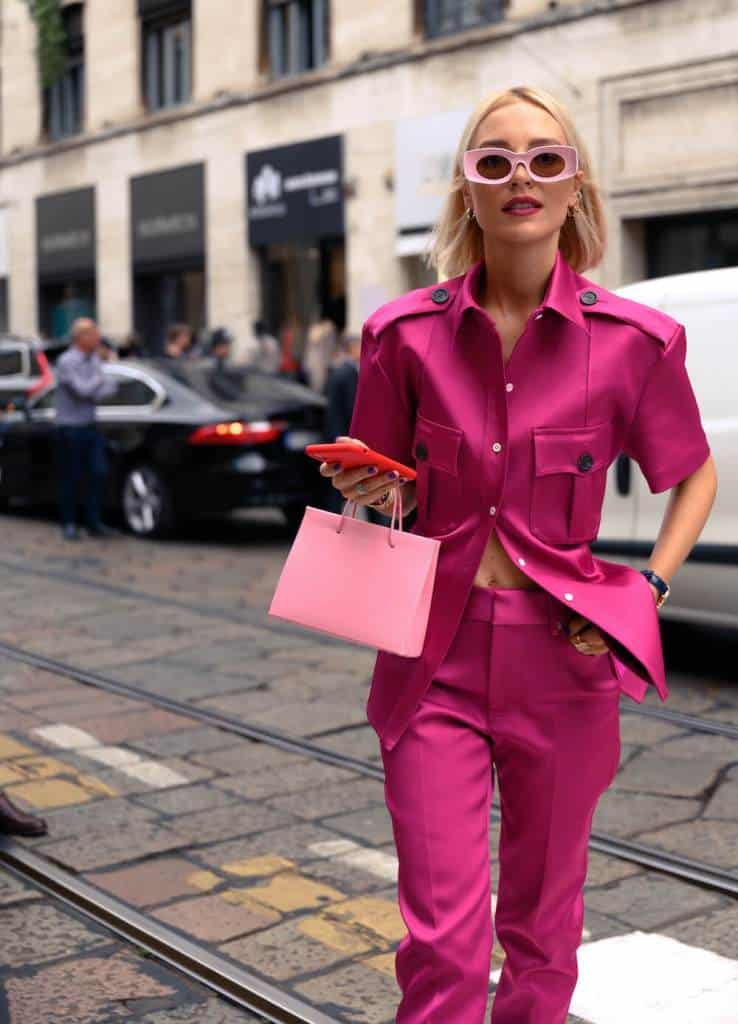 Woman wears pink at Fashion Week